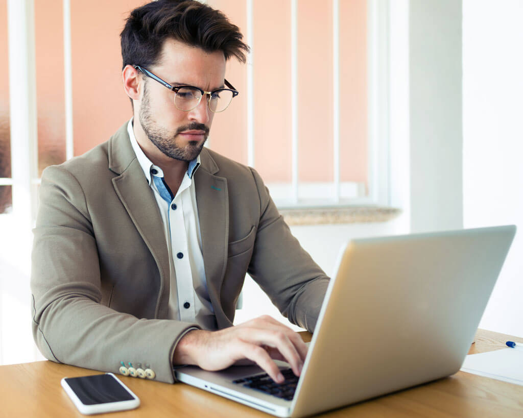 Handsome Young Business Man Working With Laptop In 6G9V222 - Mkitsol - Innovative Technology Solution Company