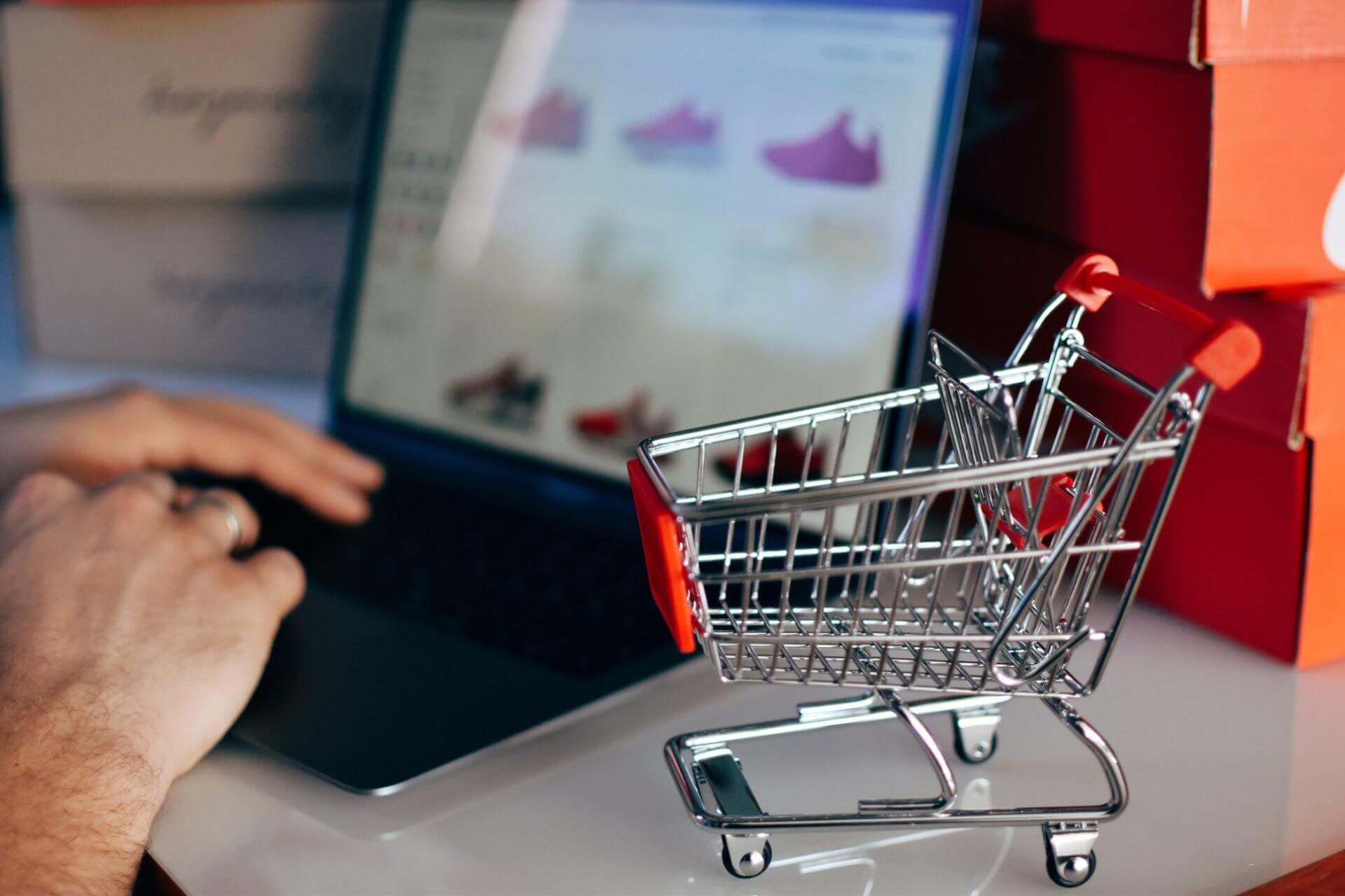 Online Shopping Concept Of Miniature Shopping Cart And Man Using Laptop For Shopping Online T20 Yna4Yp - Mkitsol - Innovative Technology Solution Company
